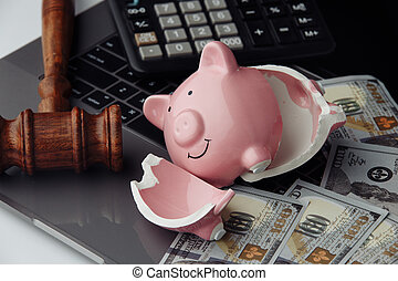 Broken piggy bank, cash and wooden gavel on keyboard. Auction and bankruptcy concept