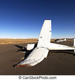 Broken plane on tarmac at airport.