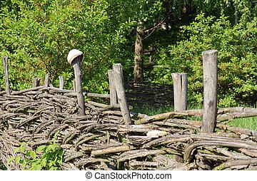 Broken pot on wooden old fence
