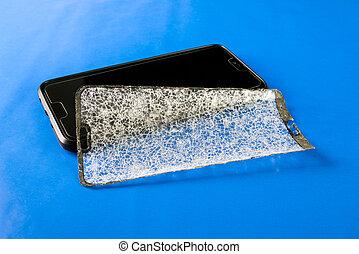 Broken protective glass on smartphone