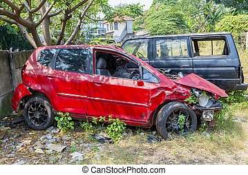 Broken red car because of the crash accident