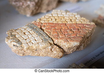 Broken remains of excavated Mosaic floor pieces from a Roman Villa in West Sussex, England