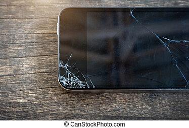 Broken screen of black smart phone