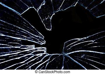 broken shattered glass on black