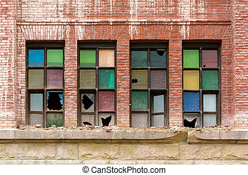 Broken Stained Glass Windows on Old Abandoned Brick Building