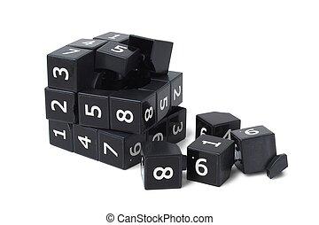 Broken sudoku cube - Broken black sudoku cube isolated on ...
