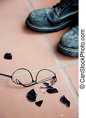 Broken Sunglasses and Black Boots