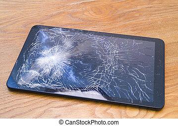 Broken tablet on the desk