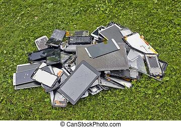 broken   telephons lie on green lawn
