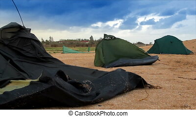 broken tents at the beach