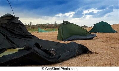 broken tents at the beach - two broken camping tents at...