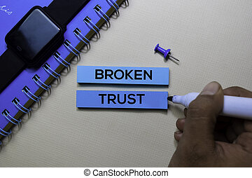 Broken Trust text on sticky notes isolated on office desk
