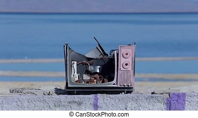 Broken TV At Water