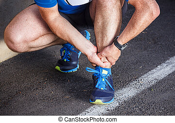 Broken twisted ankle - running sport injury. Male runner touchin