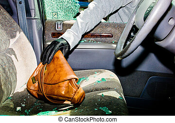 broken-up car, theft - from a broken car, a handbag is...