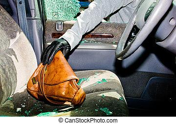 broken-up car, theft - from a broken car, a handbag is ...