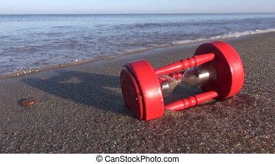 broken vintage  hourglass and sea