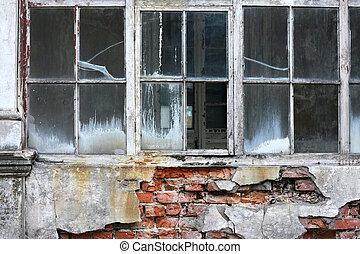 Broken window at the wall