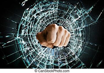 Fist punching thru a glass window