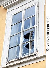 Broken window glass - A window with a broken window pane....