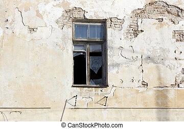 Broken window in abandoned house