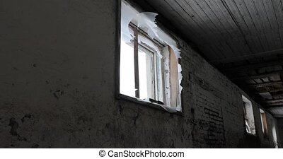 broken window in an old abandoned building.