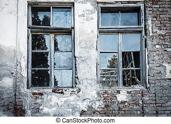 Broken window on an old decrepit building