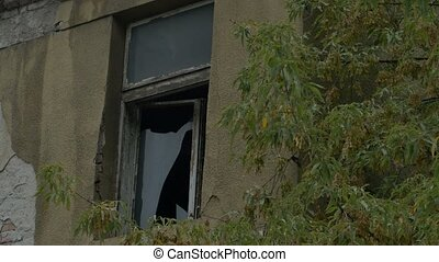 Broken Window on Desolate House - Broken glass window on a...