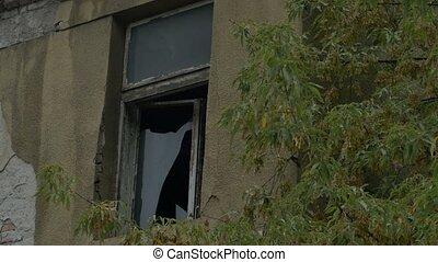 Broken Window on Desolate House