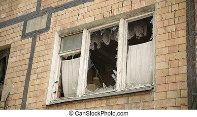 Broken Window on the War