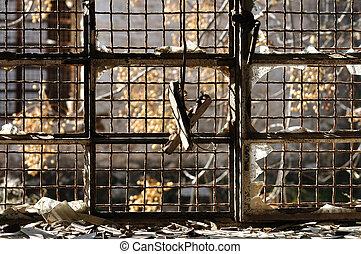 broken window rusty wire mesh