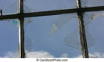 Broken window. Timelapse clouds. - View of blue sky w/...
