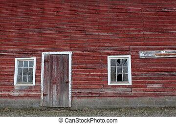 Broken windows in old red barn