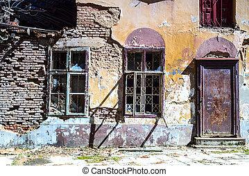 broken windows of a ruined house