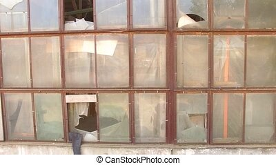 Broken Windows Of Abandoned Building - A lot of broken...