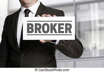 Broker sign is held by businessman