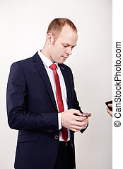 broker use of mobile phone and stand in front of white background