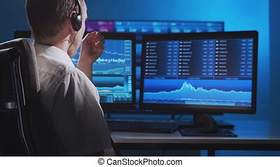 Broker works in office using workstation and analysis technology. Workplace of professional trader. Global financial markets, business strategy, exchange and banking concepts.
