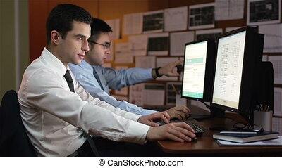 Brokers - Stock exchange brokers working late in the evening...