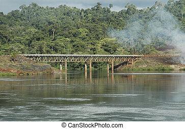 Brokopondo - Railwaybridge over the water near the...