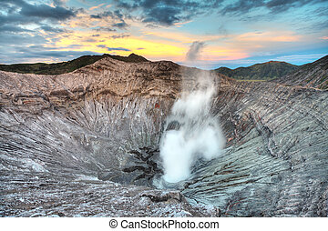 Bromo crater - Crater of volcano Bromo at sunrise time. ...