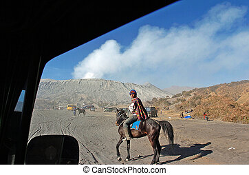 bromo - Tenggerr tribal sit a horse around the crater of ...