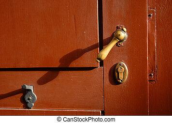 Bronce latch of a red door