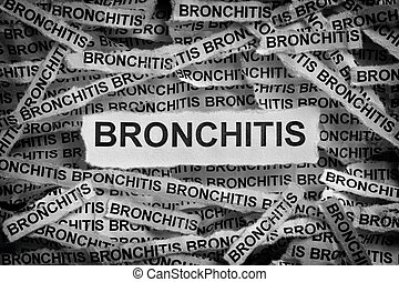 Torn pieces of paper with the word Bronchitis