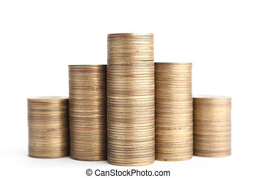 Bronze coins stand vertically in columns, isolated on white backgroud. Symmetrically posed coins symbolise weath, richness, income and profit. Close up shot.