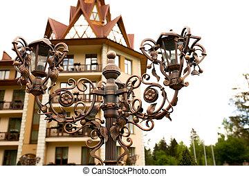 Bronze forged lantern near the hotel