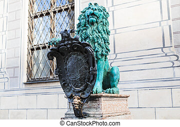 Bronze heraldic lion in front of a royal building named Alte Residenz in Munich, Germany