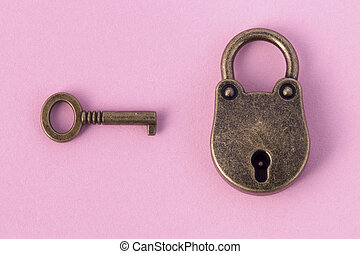 bronze key and padlock