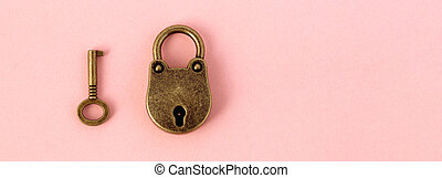 bronze key and padlock panoramic