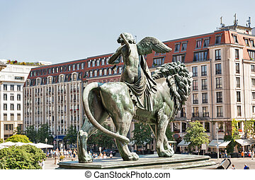 Bronze lion in front of the Berlin concert hall, Germany.